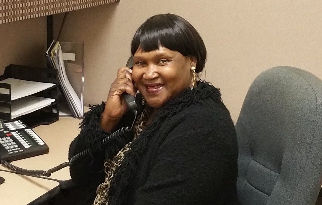 African American Female on phone at desk